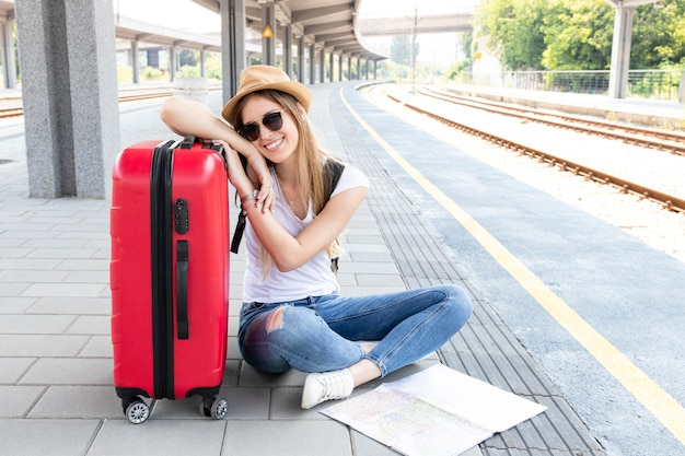 Woman with luggage in sitting on the floor Premium Photo