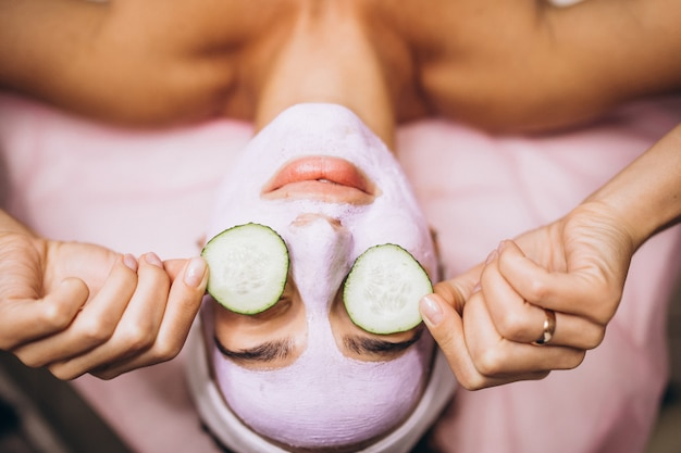 Woman with mask and cucumber on her eyes Free Photo