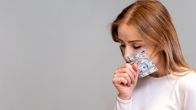 Woman with mask in quarantine coughing copy space Free Photo
