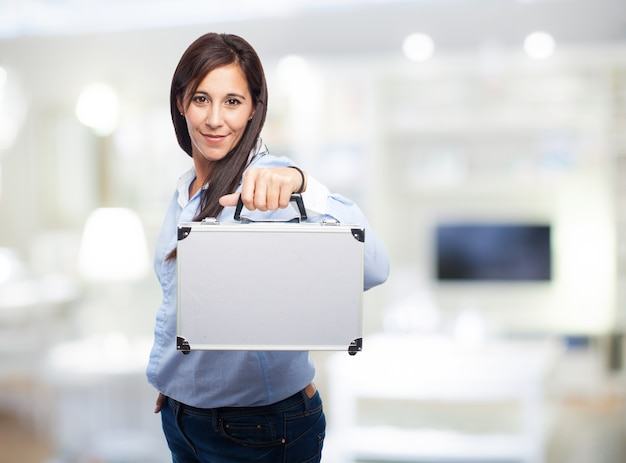 Woman with a metal suitcase Free Photo