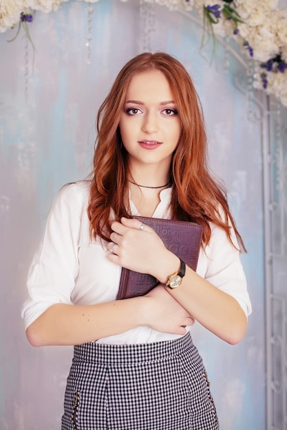 Woman with notebook. Premium Photo