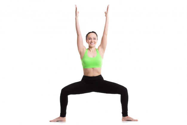 Woman with open legs and raised arms Free Photo