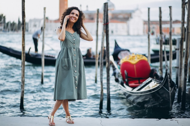 Woman with phone on vacation in venice Free Photo
