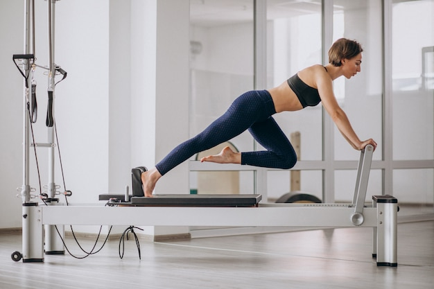 Woman with pilates trainer practising pilates Free Photo