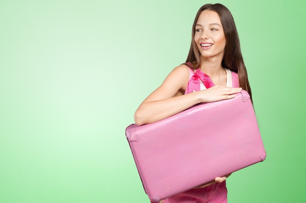 Woman with pink suitcase Premium Photo