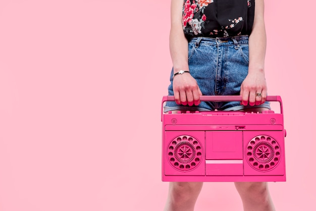 Woman with pink tape recorder Free Photo