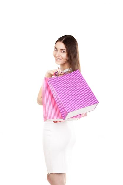 زن با کیسه های خرید در شانه اش