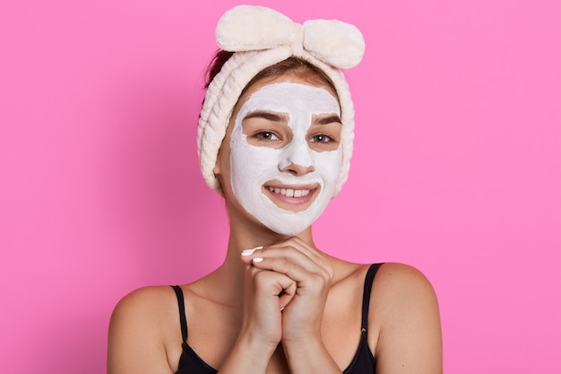 Woman with purifying white mask on her face Free Photo