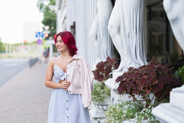 Woman with red hair and flowers Free Photo