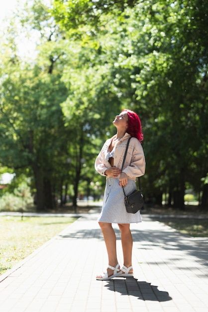 Woman with red hair in park Free Photo