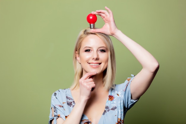 Woman with a red light symbolizing the idea above her head Premium Photo