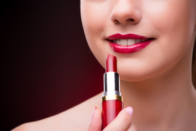 Woman with red lipstick in beauty concept Premium Photo