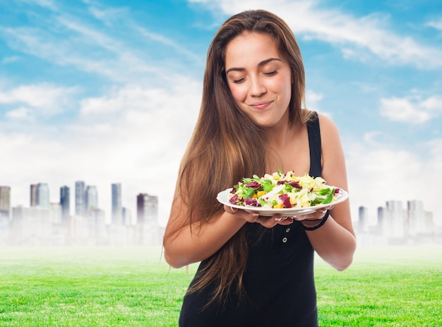 Woman with a salad in hands Free Photo
