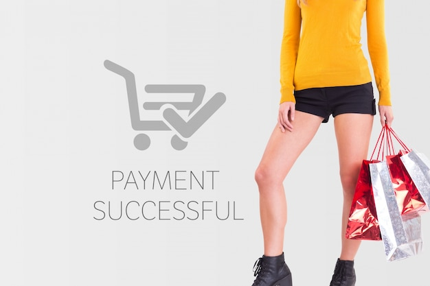 Woman with shopping bags and payment successful Free Photo