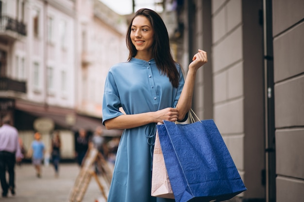 Woman with shopping bags Free Photo