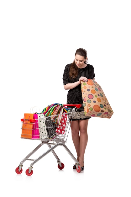 Woman with shopping cart and bags isolated on white Premium Photo