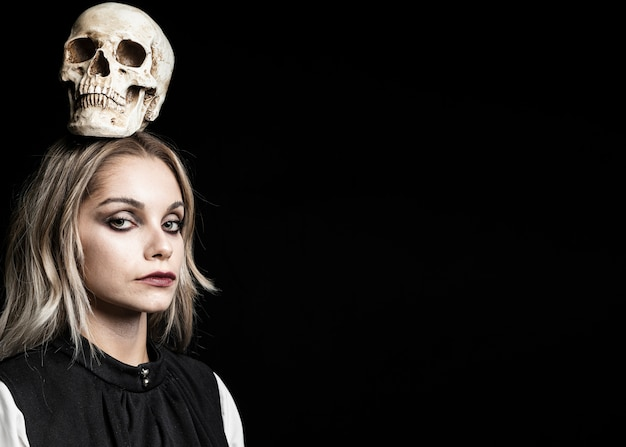Woman with skull on head and copy space Free Photo