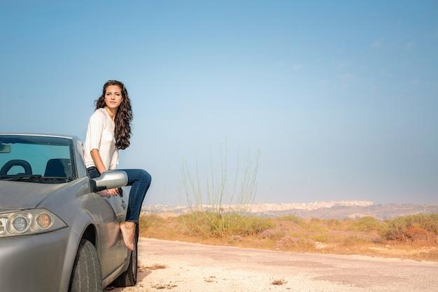 Woman with a sport car Premium Photo