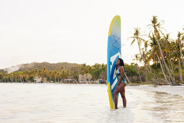 Premium Photo Woman With Sup Surfing Board