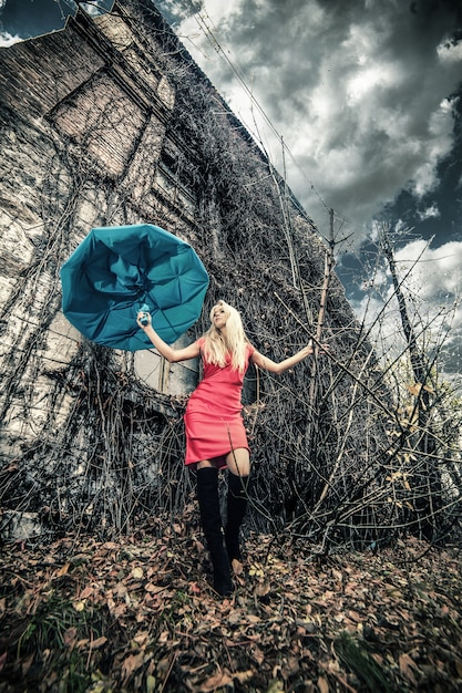 Woman with umbrella in abandoned place Free Photo