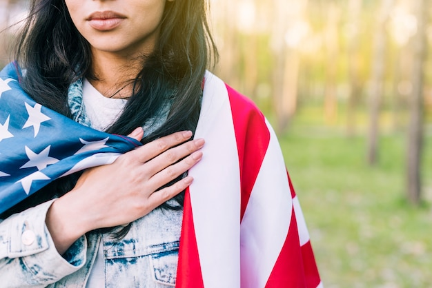 Woman with usa flag on shoulders Free Photo