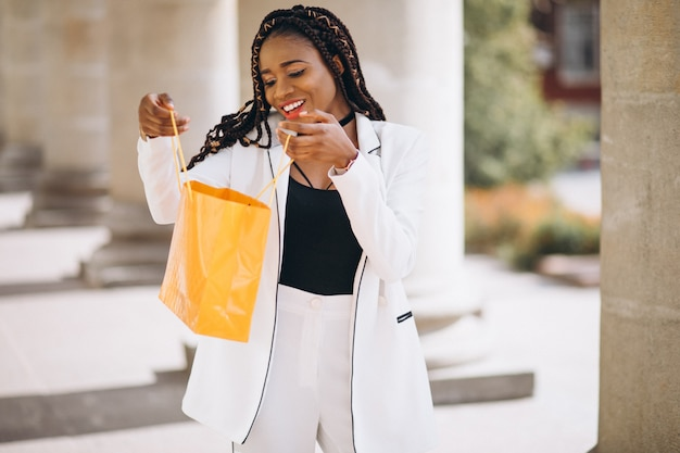 Woman with yellow shopping bags Free Photo