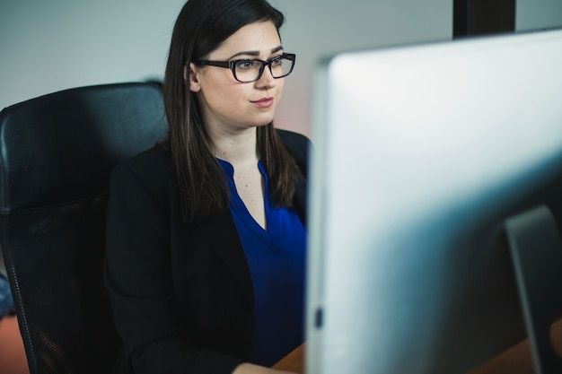 Woman working at computer in office Free Photo