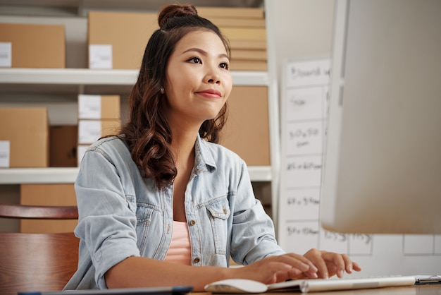 Woman working on computer Free Photo