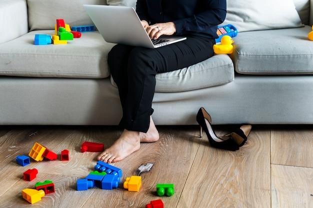 Woman working on laptop on sofa Premium Photo