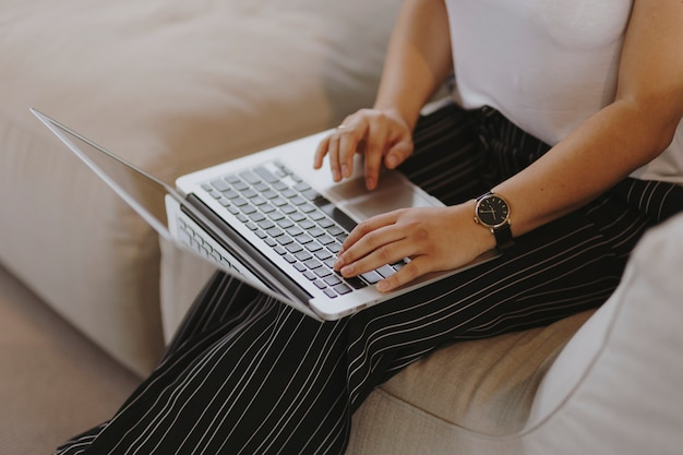 Woman working on a laptop Free Photo