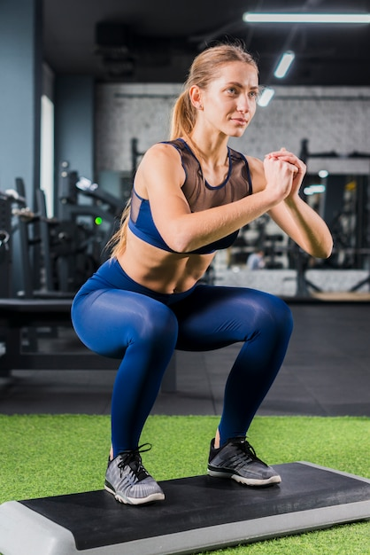 Woman working out in the gym Free Photo