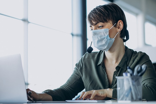Woman working at record studio and wearing mask Free Photo