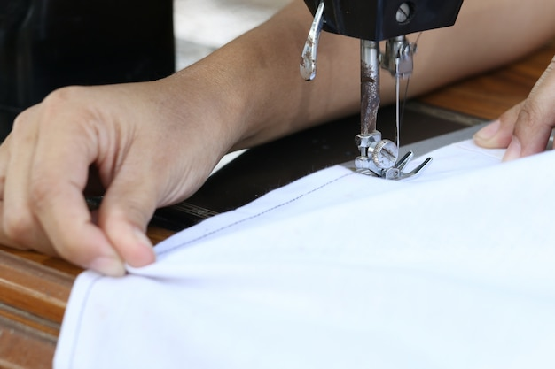 Woman working with sewing machine. Premium Photo