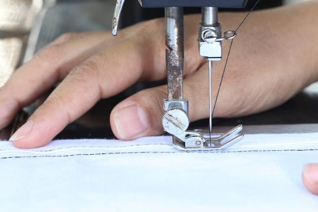 Woman working with sewing machine. Premium Photo