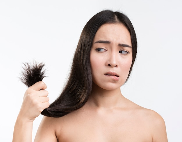 Woman worried for her hair Free Photo