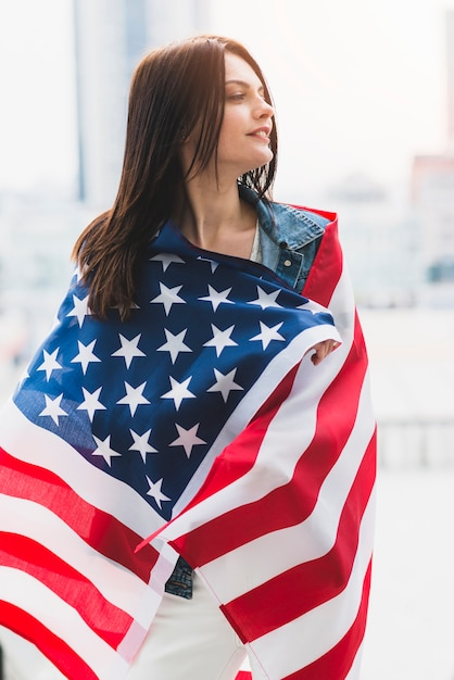 Woman wrapped in stars and stripes flag Free Photo