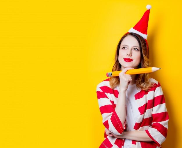 Woman writer with big pencil Premium Photo