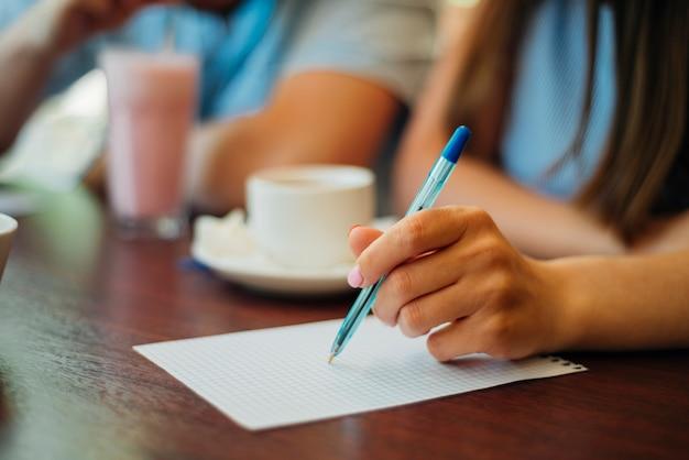 Woman writing on sheet of paper Free Photo