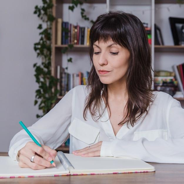 Woman writing Free Photo