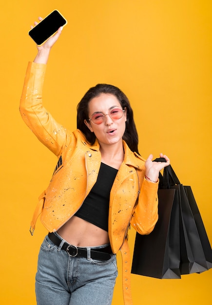 Woman in yellow jacket being happy Free Photo