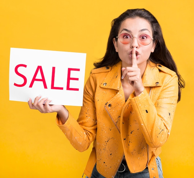 Woman in yellow jacket silent gesture sales Free Photo