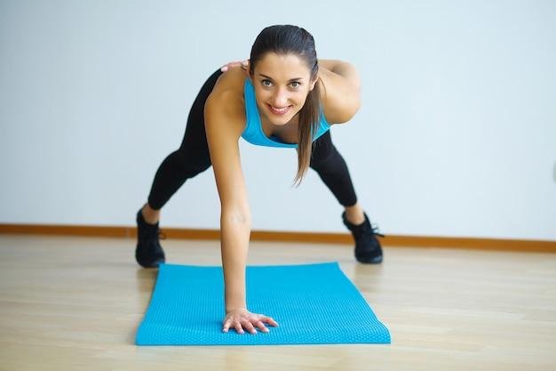 Woman in yoga class making upward-facing dog pose, Premium Photo