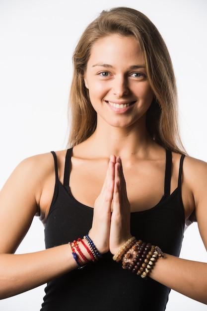 Woman yoga teacher in various poses asana isolated on white Premium Photo