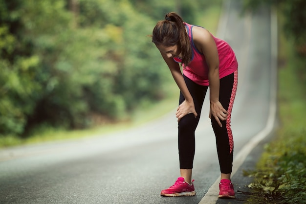 Women are tired from jogging on a steep slope Premium Photo