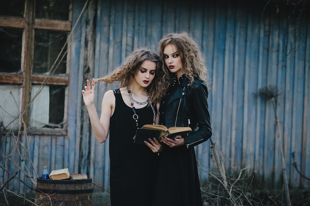 Women disguised as witches in an abandoned house Free Photo