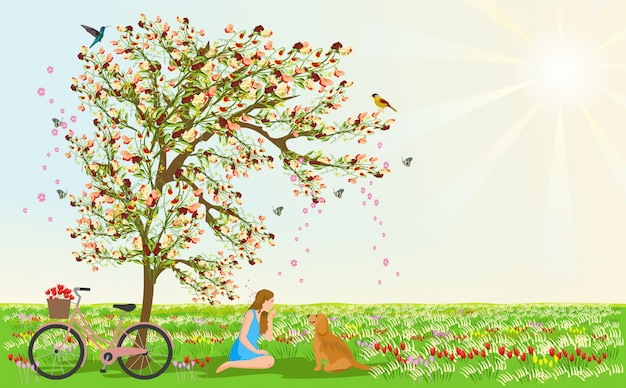 Women and dogs sit under the flower tree Premium Photo