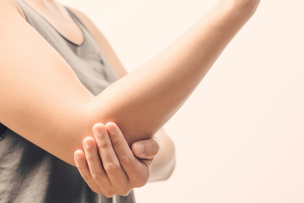 Women elbow pain injury, healthcare and medical concept Premium Photo