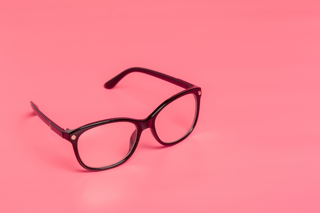 Women fashion glasses close up on bright colored Premium Photo