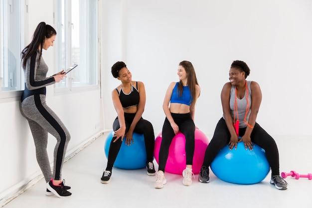 Women at fitness class on break Free Photo