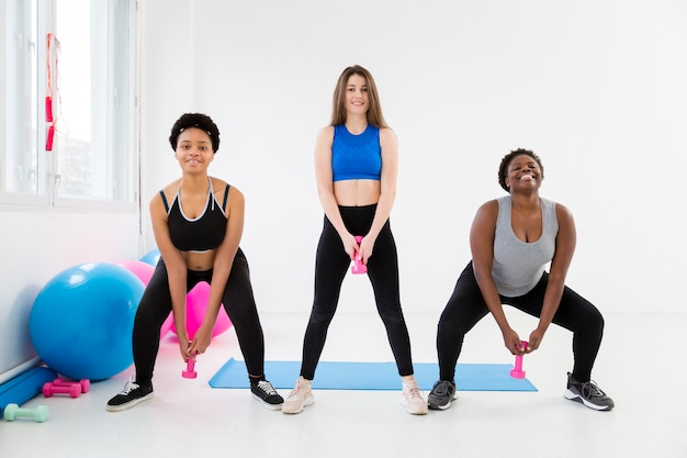 Women at fitness class working out Free Photo